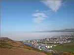 A bank of sea mist over the Town of Peel - (25/4/04)