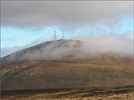 The summit of Snaefell peeking through the mist - (23/11/03)